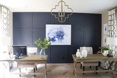 Gorgeous home office makeover with Benjamin Moore Hale Navy board and batten walls, gold quatrefoil chandelier, and Windsor Smith Riad drapes.