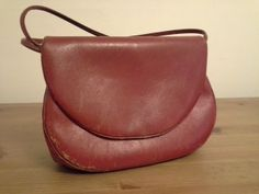 This cute leather bag dates back to the 1950s. Found it with my Aunt's identification dated 1954.