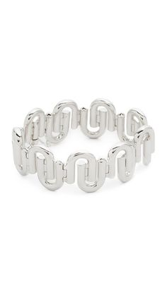 Sleek, overlapping links form a substantial chain on this polished Eddie Borgo bracelet. Hinged clasp with security lock.