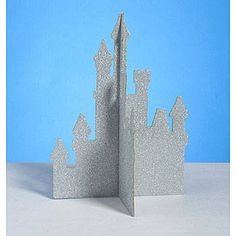 Our silver Glitter Castle Centerpiece has the look of a fairytale castle with it's four glittered sides. Each cardboard castle centerpiece measures 14 inches high x 10 inches wide.