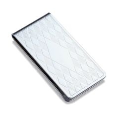 """This beautiful money clip would make a great gift for a birthday, Christmas, graduation, your best man or groomsmen, Father's day, a retirement, or any special occasion. This money clip is high polish chrome plated, and features a diamond pattern on the front and back. It has a diamond center for engraving initials or a monogram. Engraving fee is included in purchase price. The clip measures 2 3/8"""" x 1 3/16"""" x 5/16"""". Comes in a small gift box."""