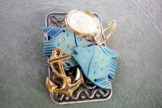 Beach inspired collage pin with anchor fish by OutsiderArtJewelry