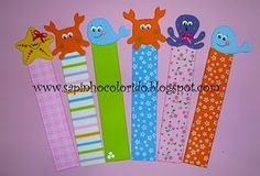 DIY Bookmarks:  Strip of scrapbook paper (glue two together for strength), two stickers back to back at top.  Adorable.