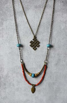 Boho layered necklace Endless Knot pendant turquoise & red beads double chain - unique trends finds handmade trendy jewelry - unique spiritual woman gift by ANANKE JEWELRY anankejewelry.etsy.com Kollier | Collana | Colar | Kолье | Collar | Gargantilla | halsband | 项链 | Jewellery | Necklaces