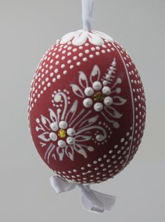 Beautiful and unique to the Moravian region, These hand crafted, one of a kind, heirloom hens eggs are beautiful hanging from blossom branches, pussy willows, or in a pretty bowl or dish for your holiday centerpiece.  A wonderful gift for Christmas, Easter, weddings, baby showers, or for the discerning collector.  Designs are naturally purified and whitened, then hand decorated with a pin and beeswax dye. Ornate and beautiful.  Finished with an archival, industrial grade UV resistant glaze…