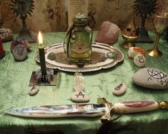 Lovely altar centered around something like a wee shrine. Wicca Altar, Wiccan, Magick, Witchcraft, Sabbats, Book Of Shadows, Stone Painting, Occult, Flower Vases