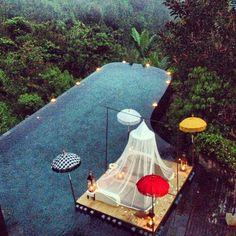 Enjoy a gourmet Thai menu on a lounge set atop a floating stage at Ubud Hanging Gardens.
