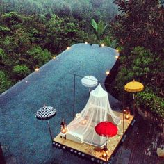 Enjoy a gourmet Thai menu on a lounge set atop a floating stage at Ubud Hanging Gardens.