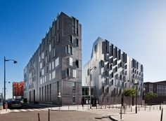 M9-C Building, Paris, France;  this building has four different uses – school, culture, housing and parking;  designed by BP Architectures;  photo by Sergio Grazia