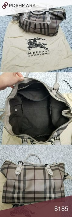 Burberry Diaper Bag Authentic Burberry Diaper Bag lightly used. Haves some light wear on handles of rubbing of the paint also some light rubbing on the corners. Inside is clean with lots of room and pockets also haves an outside big pocket. Comes with dust bag and long strap.  CHECK OUT MY OTHER LISTINGS ON MORE AMAZING DEALS Burberry Bags Baby Bags