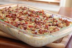 ---BLT mac and cheese--- 4 cups of whole milk  1 box VELVEETA®prepared cheese loaf (32 oz size), cut into large cubes  2 cups shredded sharp cheddar cheese  1/2 stick of butter  1 pound of elbow macaroni  1 (9 oz) bag of fresh spinach  1 pint of small cherry tomatoes  1 pound of bacon, cooked and crumbled  1 cup Progresso® Panko style bread crumbs (Plain or Italian)