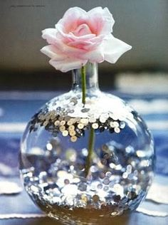 Sequins… in water. Budget-friendly centerpiece. It looks so simple yet elegant which is what I'm going for.