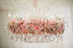 Chandelier with artificial roses, amazing reception space chandelier