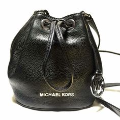 NWOT Michael Kors Mini Bucket Black Cross Body Bag Brand new without tags. Small but adorable and fits all necessities. Black smooth leather with silver tone hardware. Trade value $250 Michael Kors Bags Crossbody Bags