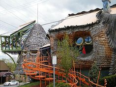 This groovy Cincinnati home for sale took architect Terry Brown more than a decade to pull off. Brown and students from the University of Cincinnati College of Design, Architecture, Art and Planning sculpted the home from a variety of mixed materials, including wood, colored glass. shell, and ceramic.