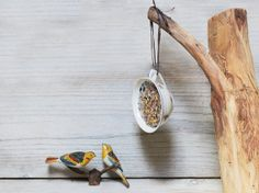 Bird feeder, Vintage French cup with bird seeds, Garden decor, Hanging coffee cup