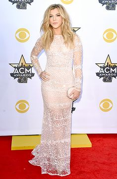 The Band Perry's leading lady played peekaboo in a blush Michael Cinco dress with confetti-style beading. To complete the outfit, she added a peach Amanda Pearl clutch and diamond jewels.
