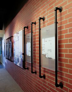 custom pipes used to hold floor plans on brick wall. www.themill.ca north vancouver, bc canada
