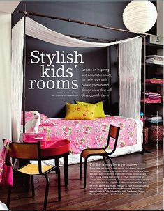 pink flowered bedspread and dark grey wall