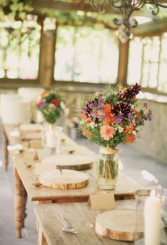 harvest table settings and colorful wildflower centerpieces | Photo by Michele M. Waite