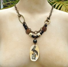 by Sheri Mallery Porcelain pendant and beads by SlinginMud