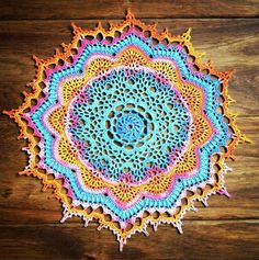 """I looked around until I found a pattern that might work with variegated  thread again. I have a few skeins of the AMB thread and I really wanted to  use this one on a good pattern. When I stumbled upon """"Stunning"""" by Patricia  Kristoffersen, I knew I the long colorway would really look stunning with  it.  I used a 1.75mm hook. The completed piece is 11.5-inches (29 cm) in  diameter.  I love how the variegation allows the """"petals"""" (midway to the edges) to  really pop out. PK included that row…"""