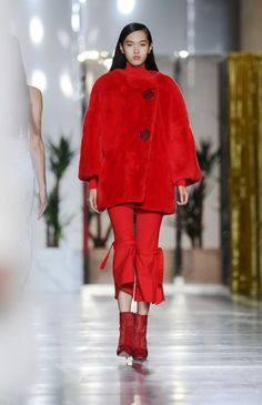 Red is fall 2015's statement maker color. See all the head-to-toe looks on the fashion week runways, including Osman.