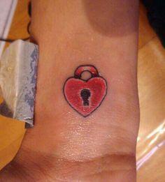 Red lock heart tattoo on wrist , heart tattoos, designs & ideas. Small Tattoos With Meaning, Small Tattoos For Guys, Small Wrist Tattoos, Heart Lock Tattoo, Key Tattoo Designs, Simple Heart Tattoos, Shape Tattoo, Elephant Tattoos, Mom Tattoos