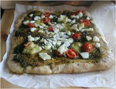 Maybe pizza maybe focaccia with a dough that has carrots in it and also rye flour