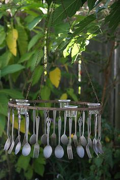 fun chandelier to hang off a tree branch and dine beneath the glow of sliverware.