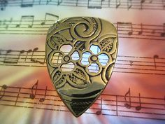 Click on the pic to buy.  Brass flower pick hand crafted by my husband!