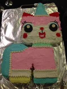 Lego Movie Unikitty Cake - Idea completely stolen from Pinterest. Skipped the fondant and went straight for a scary amount of food dye mixed with even scarier canned frosting. Helpful hint. Use Oreos for the eyes. You only need 2 of them and then you can use the rest of the bag as nourishment during the 3 hours it takes to make this damn cake.