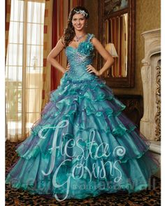 Quinceanera Dress #56245 Quinceanera dress with a mirror organza fabric and beads thruout. Lace up back.
