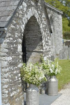 milk churns at entrance to church, another option instead of all urns