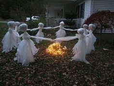 Using clear &white trash bags... Maybe glowsticks in the heads!!!!!! Spooky fun