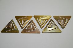 Idea for saw cutting a design to go with the shape of the metal - this is ad for 6 Brass Top Drilled Triangles with Cut Outs. $3.00, via Etsy.