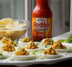 Kicked Up  Deviled Eggs!  Give those classic deviled eggs a kick by adding blue cheese and Buffalo wing sauce! They're quick and easy to prepare and will disappear in a flash!