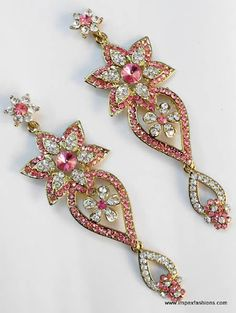 exlusvie pair of Stone studded earings, crafted and designed beautifully with high quality AD and CZ stones.    For more collections, visit us at www.impexfashions.com