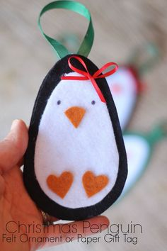Cute penguin - can be used as a felt ornament or a paper gift tag (or make a felt one & use as a gift tag then hang on the tree - just embroider the name, or write on with fabric pens!). So cute, free pattern!!: