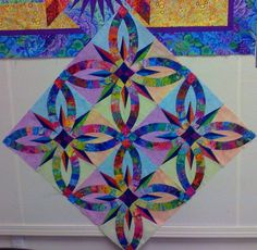 Bali Wedding Star by Susie Jacobs just stunning Pinwheel Quilt Pattern, Quilt Patterns, Star Quilts, Quilt Blocks, Wedding Ring Quilt, Wedding Rings, Batik Quilts, Free Motion Quilting, Textiles