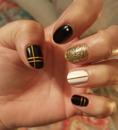 Black, White and Gold nails.