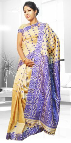 Beautiful Golden colour Tassar Pat Assam silk saree  with artistic Suta work giving an ethnic look to the collecion. This gorgeous Pat Tassar silk Saree is perfect for any festive occasion. The Saree comes with matching blouse piece, the blouse shown in the image is just for display purpose.Slight colour variation may be there in display & actual.