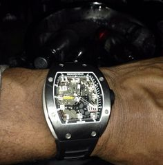 Tank shows off an expensive watch while in London