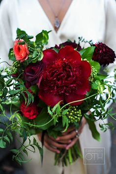 Red bouquet with peonies, roses, and greenery