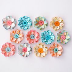 How cute are these paper flowers with button centers!!  Thanks photomamaregina!