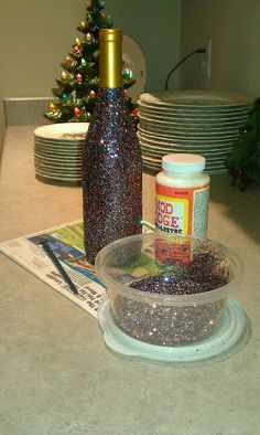 Mod podge glitter onto a wine bottle for a fun gift - apply mod podge, sprinkle with glitter, then wait 15-20 min and add a sealing layer of mod podge use a light color glitter then put string of lights in it and it will shine beautiful!!!