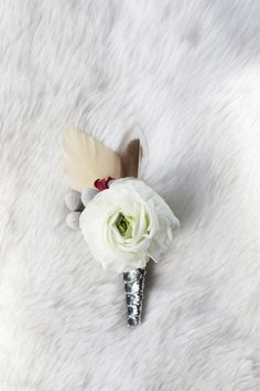 winter boutonniere for groom #groom #boutonniere #weddingchicks http://www.weddingchicks.com/2014/03/03/silver-wedding-ideas-2