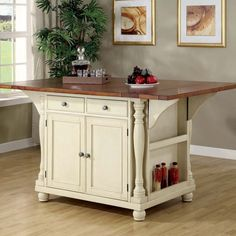 Brookstone Country Cottage Style Kitchen Island - like the folding top. Price is $780. Could DIY for lots less!