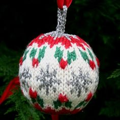 "A free knitting pattern for a Christmas Ball, my ""Holly"" Christmas ball design, available through my Two Strands knitting blog, www.twostrands.wordpress.com  Dale of Norway yarns available through my on-line yarn store, Kidsknits.com."