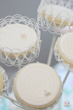 These are gorgeous:  {Video} How to Do Basic Royal Icing Stringwork - Halloween Spider Web Cookie Pops   Sweetopia